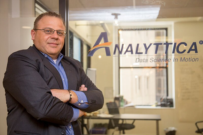 Analyttica owner poses in his office at The Mill
